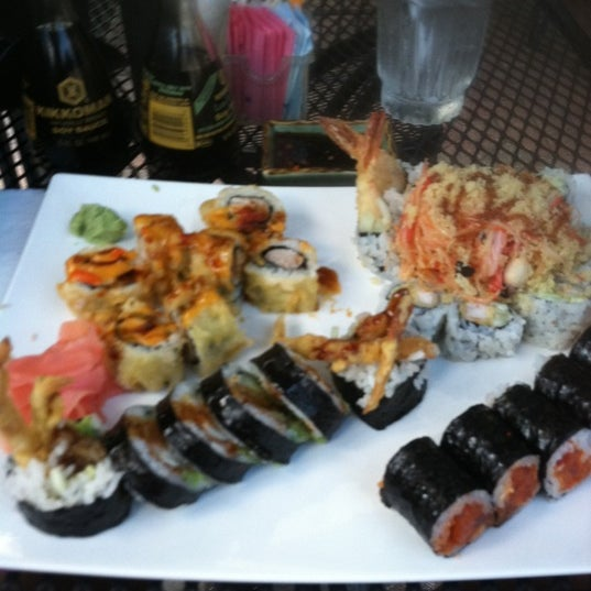 Photo taken at Sushi Cafe by Mercedes A. on 10/13/2011