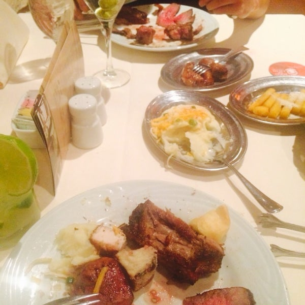 Photo taken at Fogo de Chão Churrascaria by Olivia U. on 2/6/2014