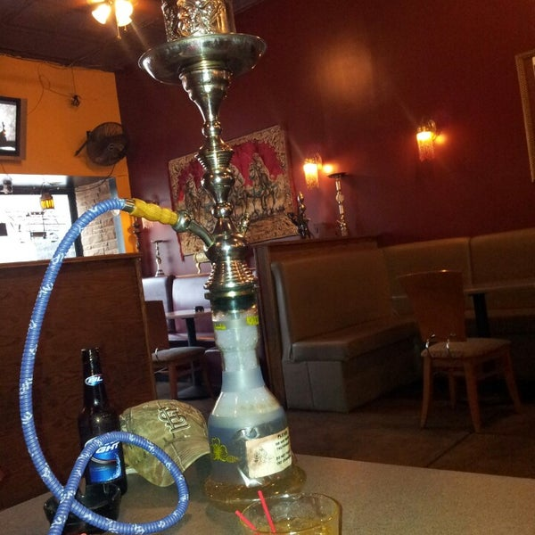 Photo taken at Nara Cafe Hookah Bar by Miranda G. on 5/2/2013