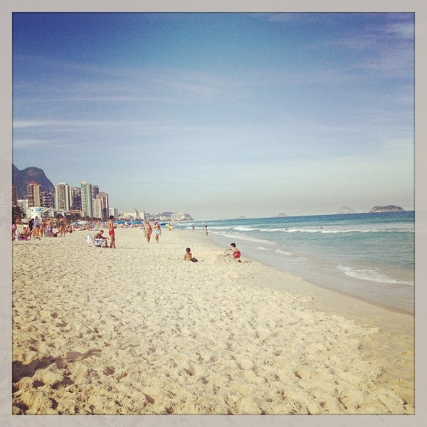 Photo taken at Praia da Barra da Tijuca by Marcella D. on 7/6/2013