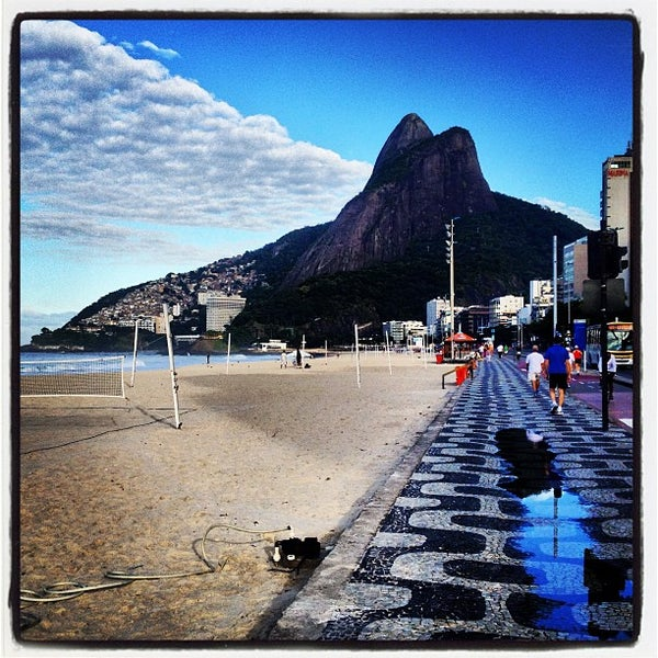 Photo taken at Praia de Ipanema by FJ A. on 5/29/2013