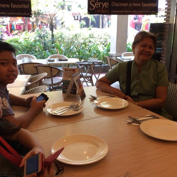 Photo taken at Sérye Café Filipino by Arnold A. on 3/2/2014