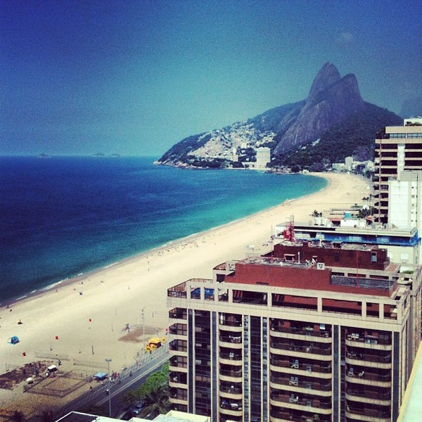 Photo taken at Praia de Ipanema by M P. on 5/27/2013