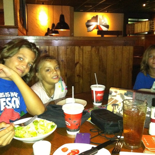 Photo taken at Outback Steakhouse by Angel M. on 7/17/2013