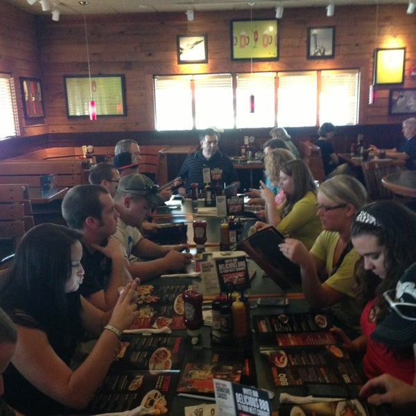 Photo taken at Smokey Bones Bar & Fire Grill by Megan M. on 8/24/2013
