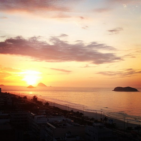 Photo taken at Praia da Barra da Tijuca by thiago f. on 12/6/2012