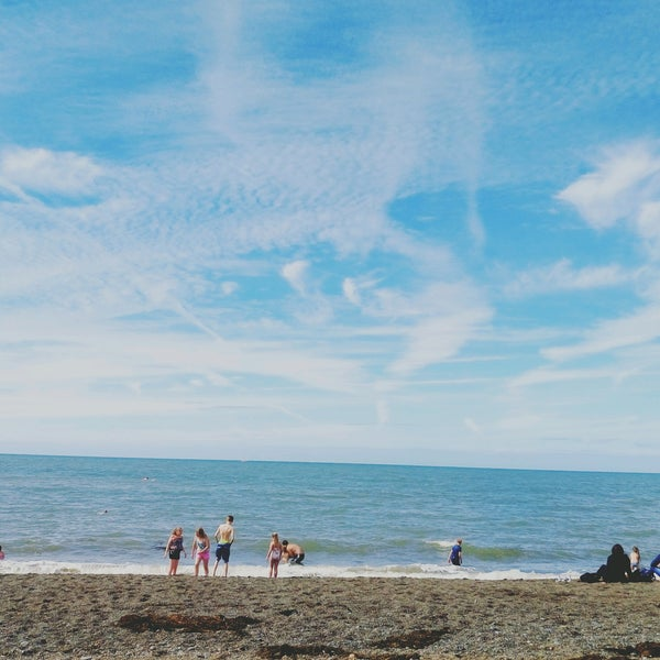 Photo taken at Aberystwyth Beach by Elif E. on 8/13/2016
