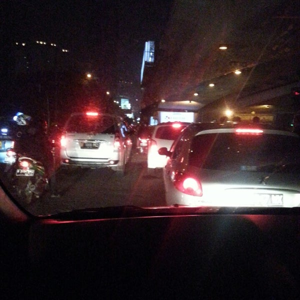 Photo taken at Perempatan Kuningan (Traffic Light) by Hanaa A. on 3/12/2014
