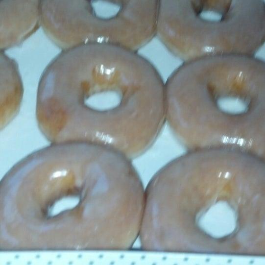 Photo taken at Krispy Kreme Doughnuts by Sharon F. on 11/16/2013