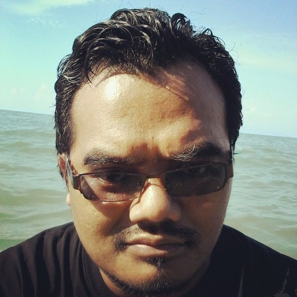 Photo taken at Teluk Bahang Beach by Fathilullail H. on 4/6/2014