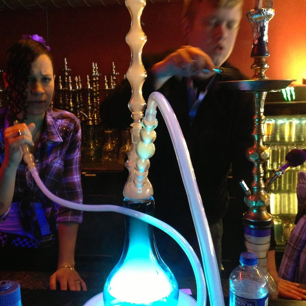 Photo taken at Sahara Nights Hookah Lounge by Ian H. on 4/18/2013