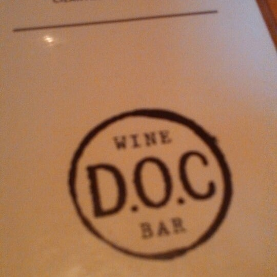 Photo taken at D.O.C. Wine Bar by elizabeth m. on 7/30/2013