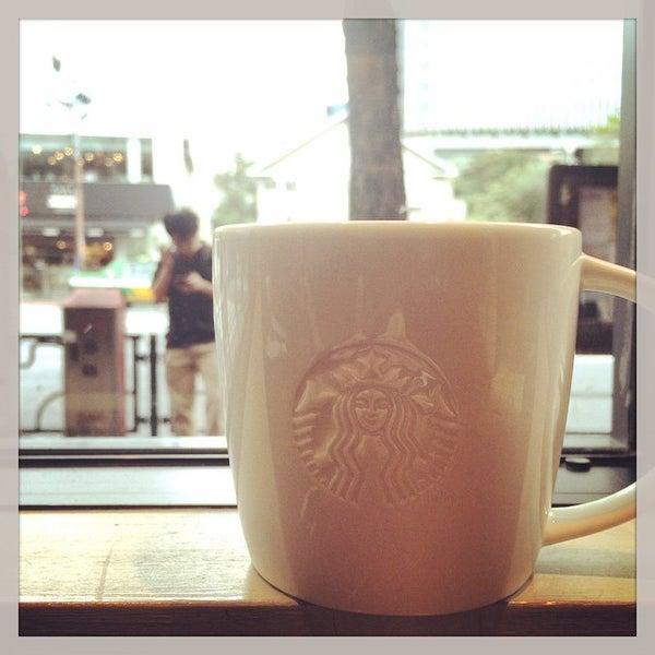 Photo taken at Starbucks Coffee 神楽坂下店 by Tomohiro O. on 10/8/2014