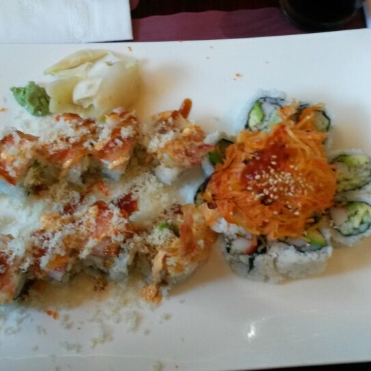 Photo taken at Sushi Cafe by Kerry C. on 6/4/2015