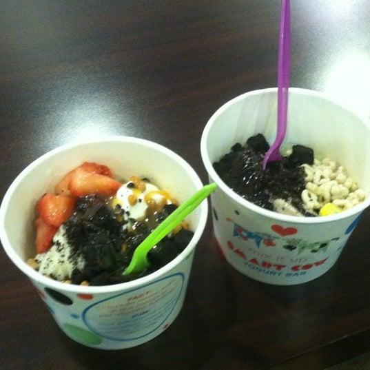 Photo taken at Smart Cow Yogurt Bar by Lauren S. on 8/20/2012