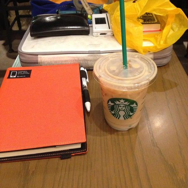 Photo taken at Starbucks Coffee 神楽坂下店 by Takashi K. on 5/6/2013