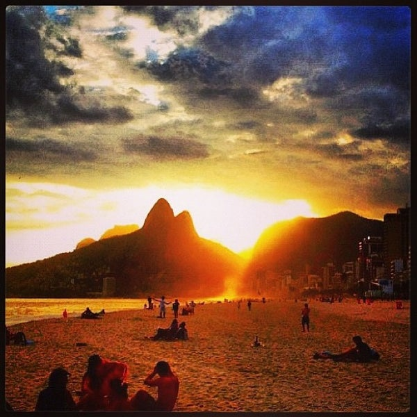 Photo taken at Praia de Ipanema by Bianca R. on 5/26/2013