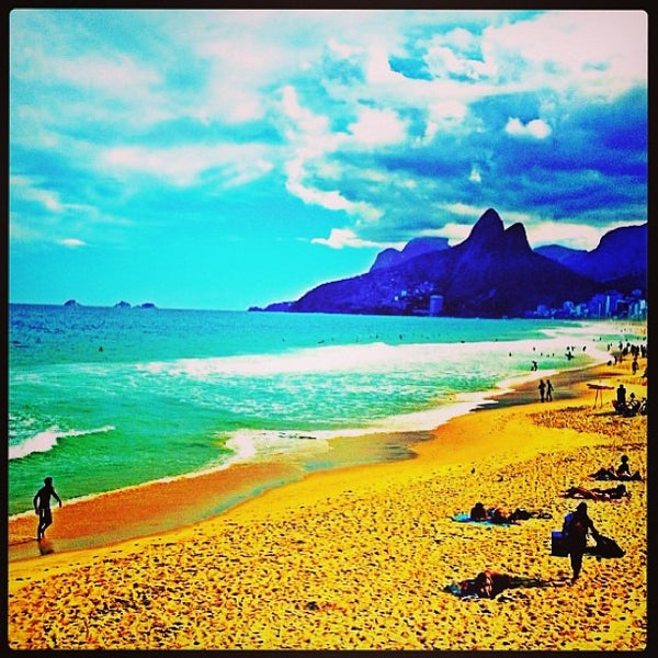 Photo taken at Praia de Ipanema by Bianca R. on 6/4/2013