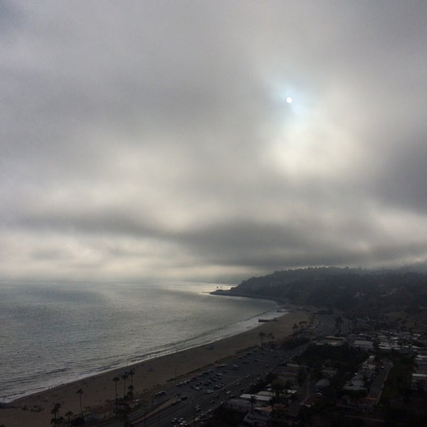 Photo taken at Pacific Palisades Beach by Ageo L. on 6/23/2016