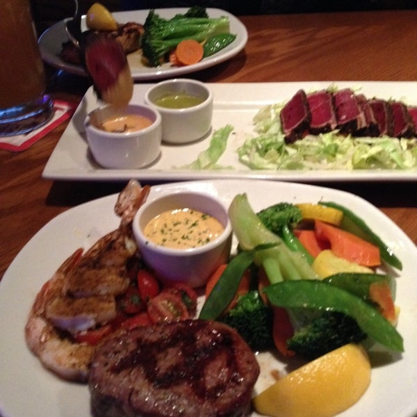 Photo taken at Outback Steakhouse by Aaron C. on 3/2/2014