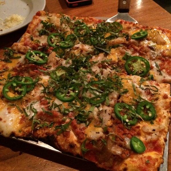 Photo taken at Joe Squared Pizza & Bar by Mia U. on 4/18/2014