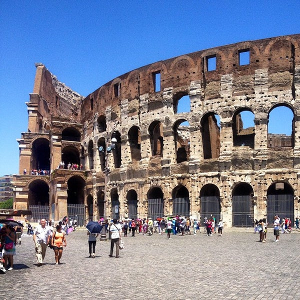 Photo taken at Piazza del Colosseo by Nikita K. on 6/23/2013
