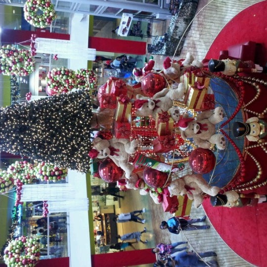 Photo taken at Trincity Mall by Dwight N. on 12/21/2012