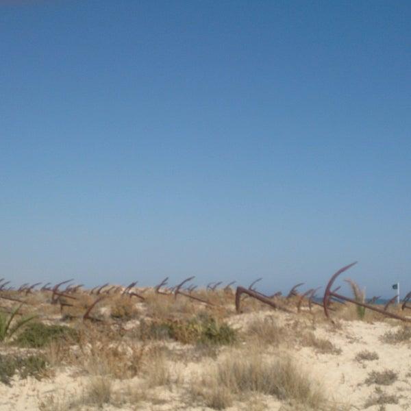 Photo taken at Praia do Barril by Maria R. on 8/28/2016