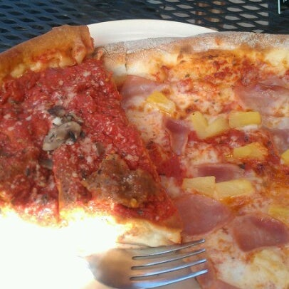 Photo taken at Regents Pizzeria by Kevin D. on 9/13/2012