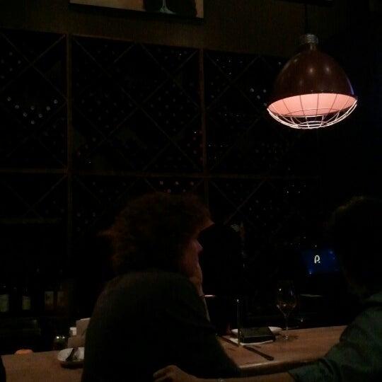 Photo taken at JoJo Bistro & Wine Bar by Adam K. on 10/26/2012