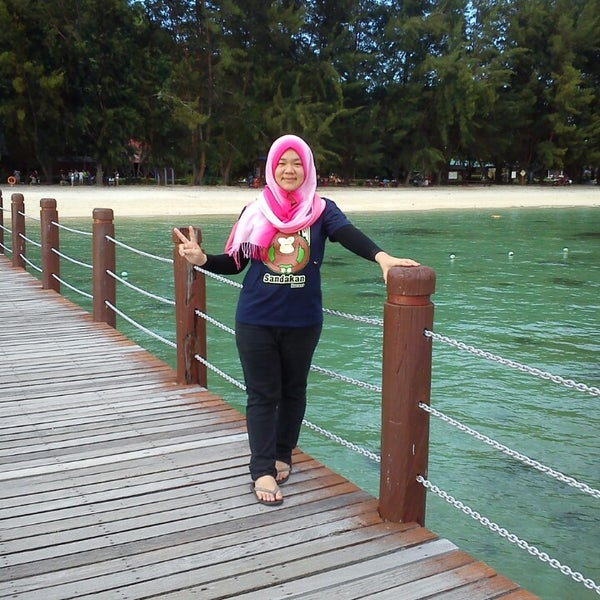 Photo taken at Manukan Island Jetty by Malisah H. on 11/1/2014