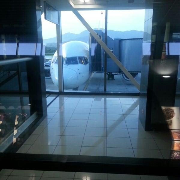 Photo taken at Gate 5 Aeropuerto Internacional Juan Santamaria by Paul L. on 5/4/2014