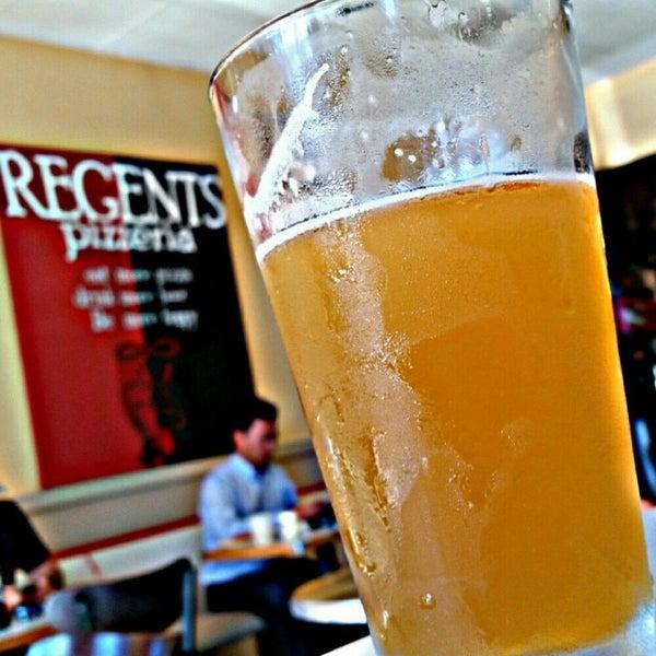 Photo taken at Regents Pizzeria by Kris on 8/16/2014