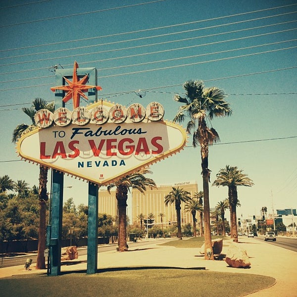 Photo taken at Welcome To Fabulous Las Vegas Sign by Marina Z. on 6/26/2013