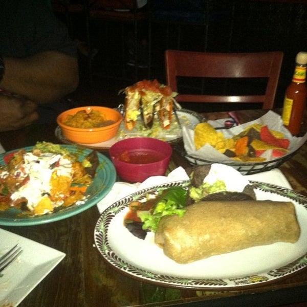 Photo taken at Burrito Bar & Kitchen by Steve J. on 4/18/2013