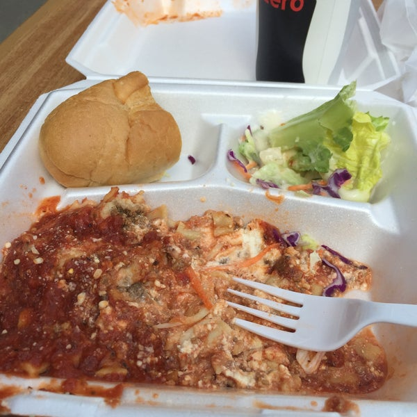 My half eaten lunch. Lasagna, salad, roll and drink $8.40. Not bad #lunchonbroad #atldowntown