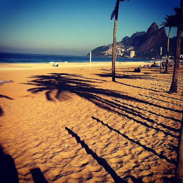 Photo taken at Praia de Ipanema by Bruno A. on 6/29/2013