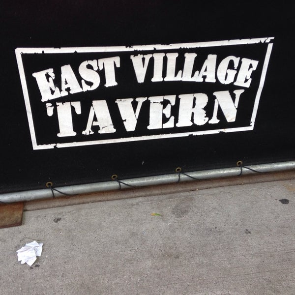 Photo taken at East Village Tavern by Angie N. on 6/22/2014