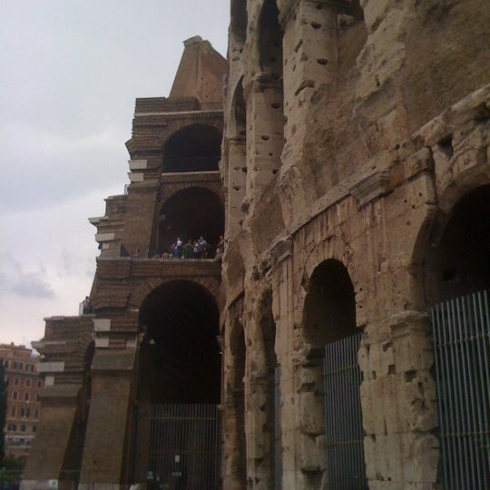 Photo taken at Piazza del Colosseo by Cesar T. on 5/26/2012