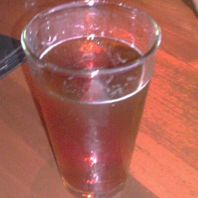 Photo taken at The Lion & Rose British Restaurant & Pub by Tyrone M. on 5/25/2012