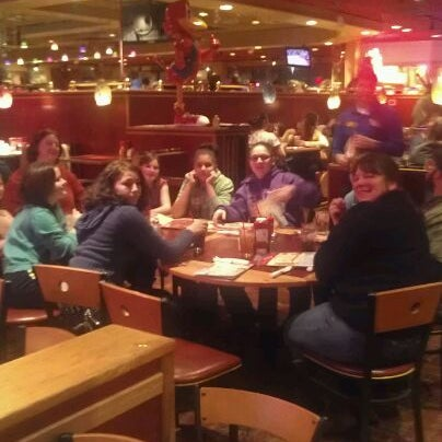 Photo taken at Red Robin Gourmet Burgers by Claire F. on 2/19/2012