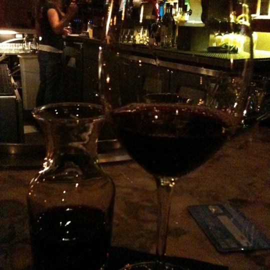 Photo taken at Lala's Wine Bar & Pizzeria by Jena B. on 1/22/2011