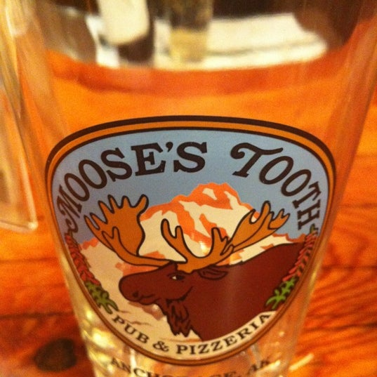 Photo taken at Moose's Tooth Pub & Pizzeria by Doug M. on 12/18/2011