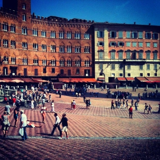 Photo taken at Piazza del Campo by Kristof P. on 9/12/2012