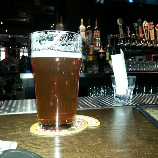 Photo taken at Thirsty Lion Pub & Grill by Brewer M. on 8/5/2012