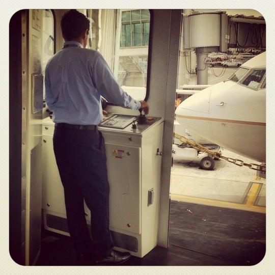 Photo taken at Gate 5 Aeropuerto Internacional Juan Santamaria by Ed V. on 5/4/2012