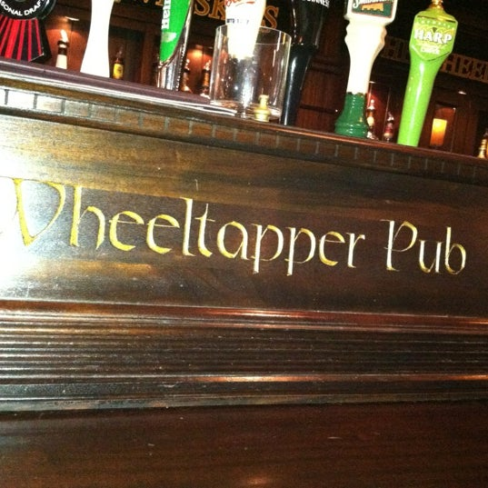 Photo taken at The Wheeltapper Pub by Amanda K. on 5/19/2012