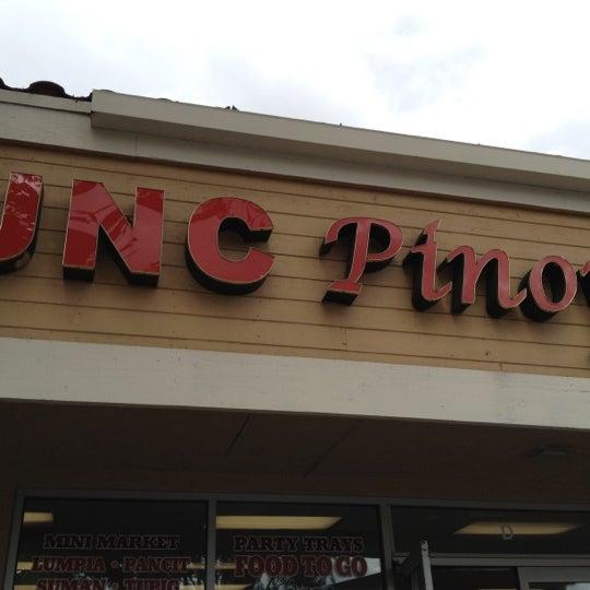 Photo taken at JNC Pinoy Foodmart Inc by Harvey C. on 4/1/2012
