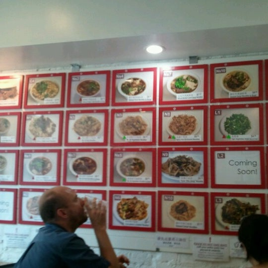 Photo taken at Xi'an Famous Foods by C.H. L. on 7/18/2012