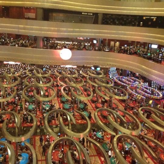 Photo taken at Marina Bay Sands Casino by Evgeny K. on 4/11/2012